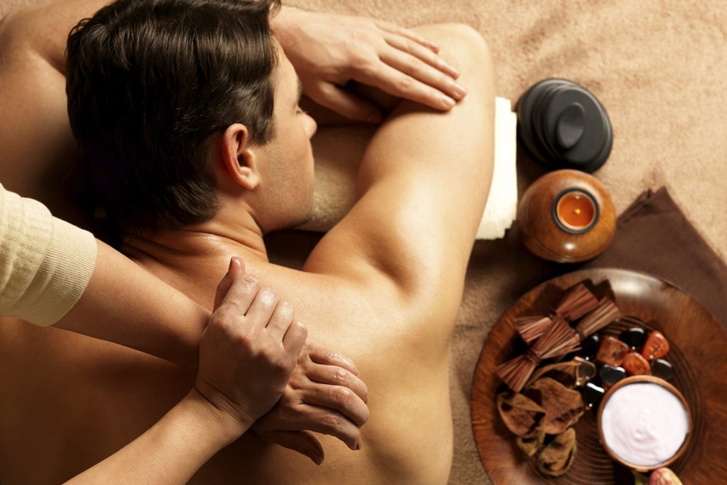 Image of A Man Relaxing While Swedish Massage Given By A Pro-Massage Therapist