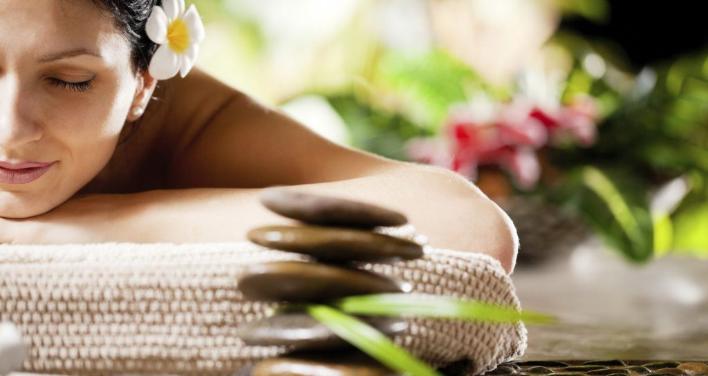 Woman Experienced Best Therapeutic Massage Therapy In A Massage Center.
