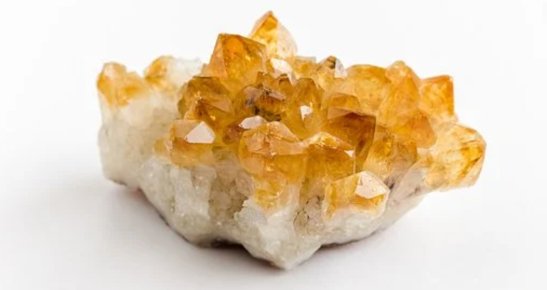 Orange Quartz Uncut Crystal Placed On A White Table.
