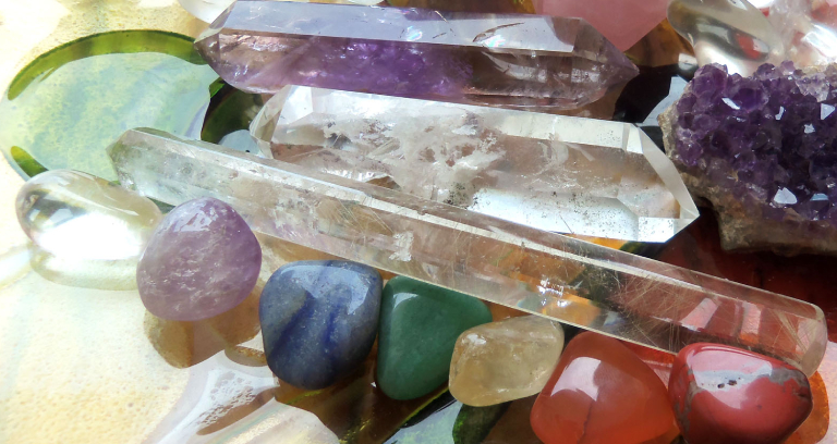 A Table Full of Crystal Stones & Illuminated Quartz.
