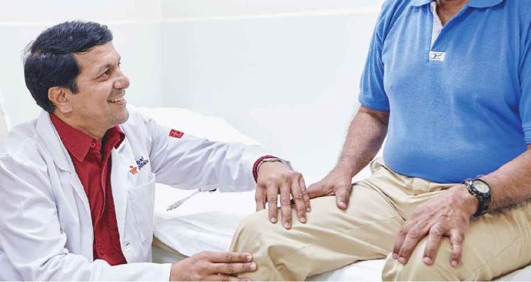 A Neurosurgeon Treating His Senior Patient For His Neuro Disorder.