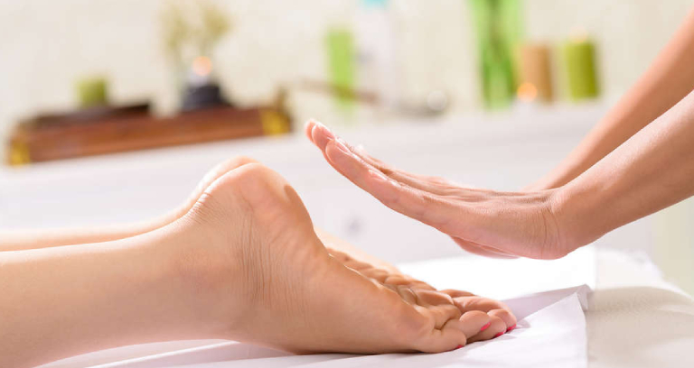 A Woman On Reiki Process For Her Leg.