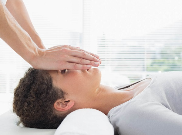 Reiki Massage On Face.