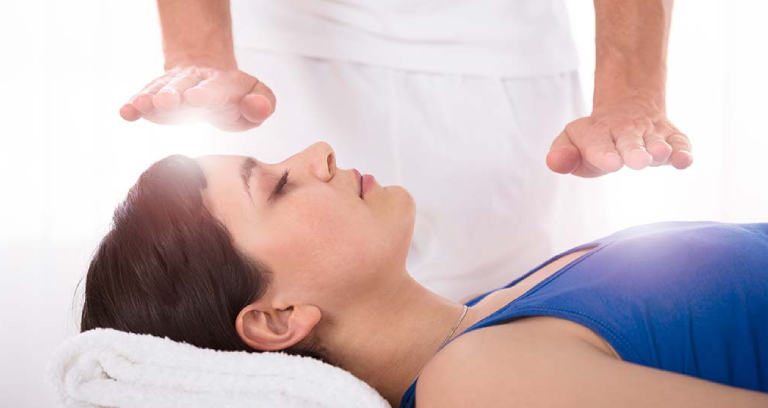 A Young Woman Getting Reiki Massage.