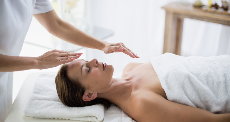 A Woman Getting Reiki Healing To Stay Away From Depression.