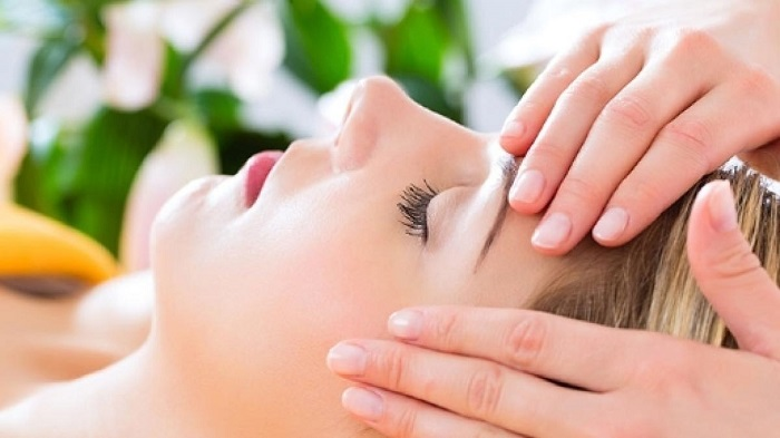A Closup Look of Woman Getting Reiki Massage For Head.