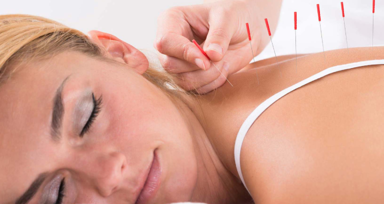A Woman Relaxing While getting Back Massage.
